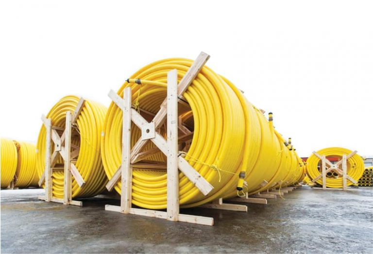 A photo of three very large spools of gas line
