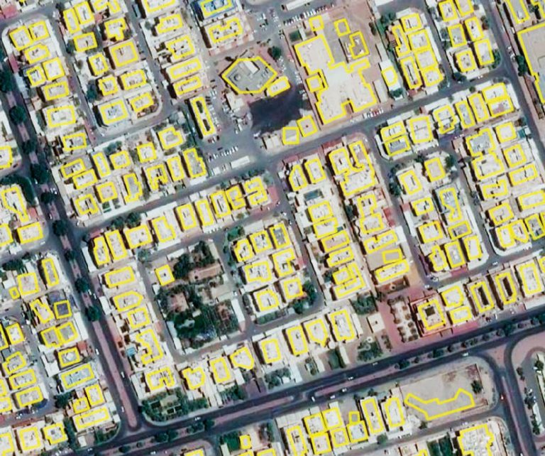 Satellite imagery of a neighborhood in Kuwait City with all the buildings outlined in yellow
