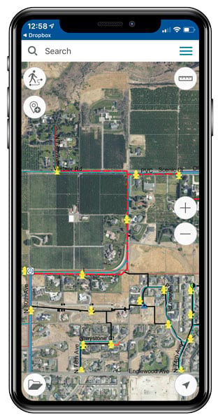 A smartphone showing an imagery-based map with a red line on it that indicates a water main that needs to be replaced