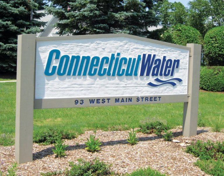 Wood sign outdoors with the words Connecticut Water