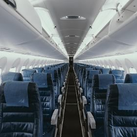 An airplane with empty seats signals a decline in business travel