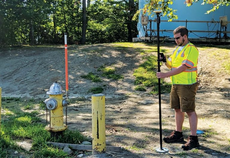 Fieldworker collecting data near a fire hydrant