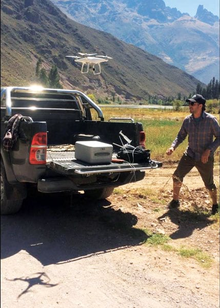 A team member flying a UAV out of a truck bed