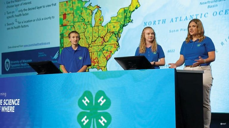 Three students from the Tennessee 4-H GIS team present on stage at the 2017 Esri User Conference Plenary Session