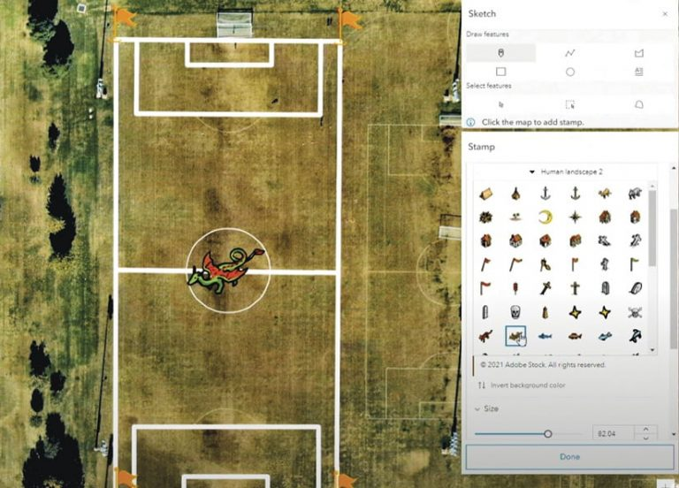 The new Map Viewer's sketch layer, showing how users can place a stamp—of a dragon, in this example—on imagery of a sports field