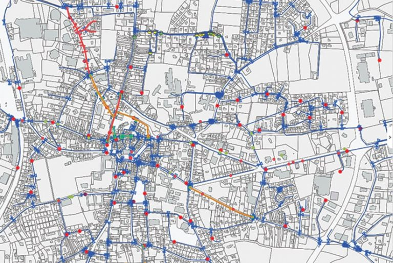 A black-and-white map with blue, red, and orange lines and dots on it