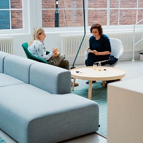 A meeting of colleagues at a modern office space