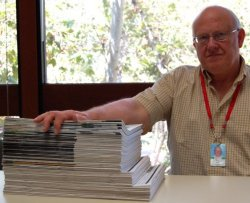 Body of Work: Editor Tom Miller with the 67 issues of ArcNews he has produced.