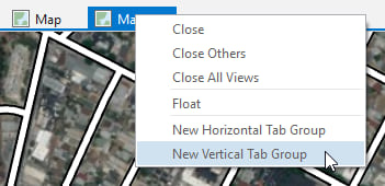 "right click on one of the map tabs and choose ""New Vertical Tab Group"""