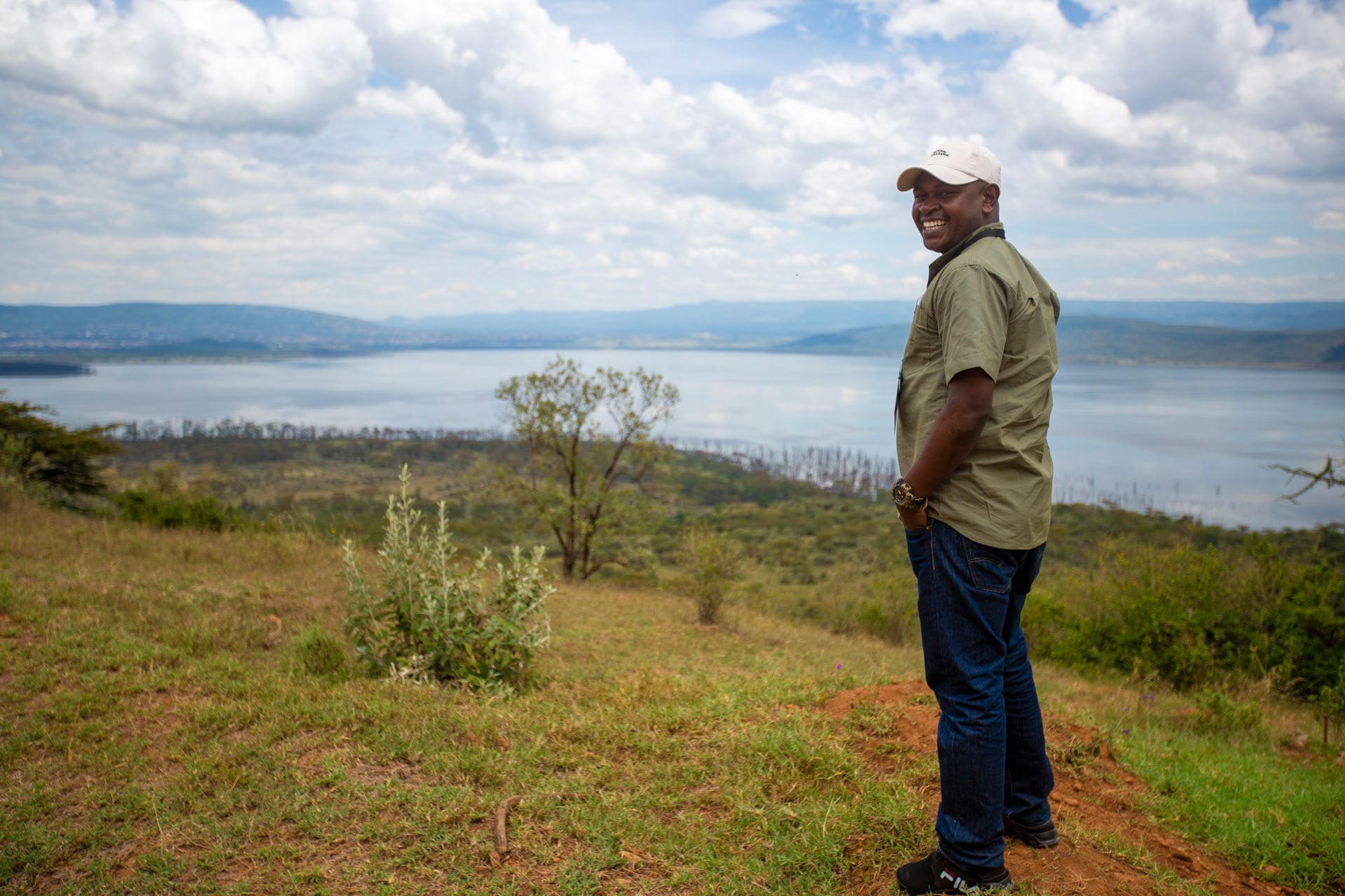 Daniel Mweta from Tanzania National Parks looks out from Out of Africa viewpoint in Lake Nakuru National Park. Photo: Ross Donihue