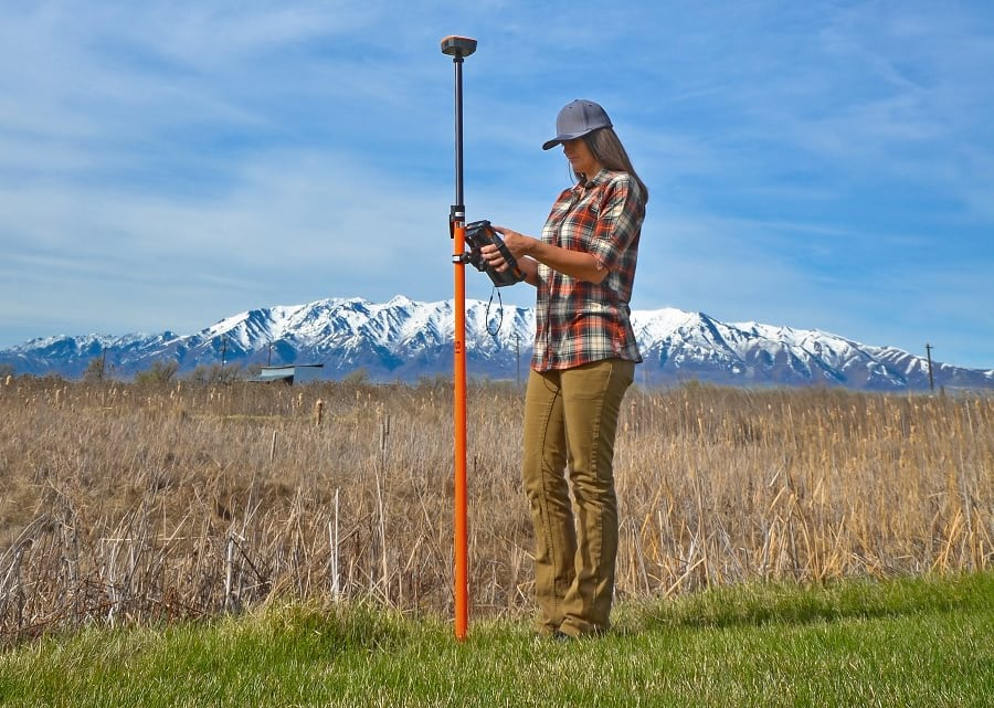 Field worker using Survey123 with a Mesa 2 and Geode GNSS receiver