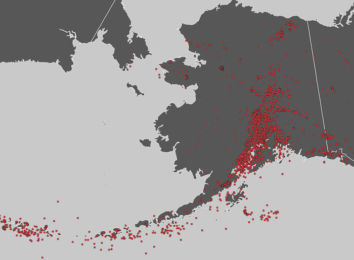 The state of Alaska with earthquakes visualized as red dots.