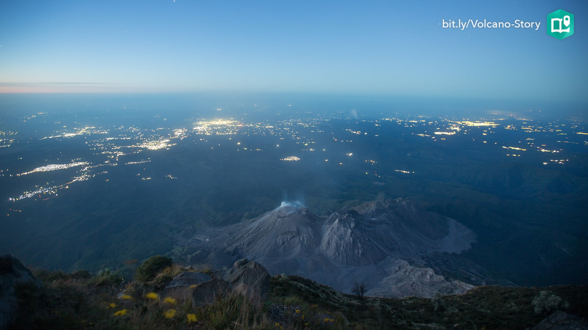 The twinkling lights of communities is visible in the pre-dawn view of Santiaguito volcano in Guatemala.