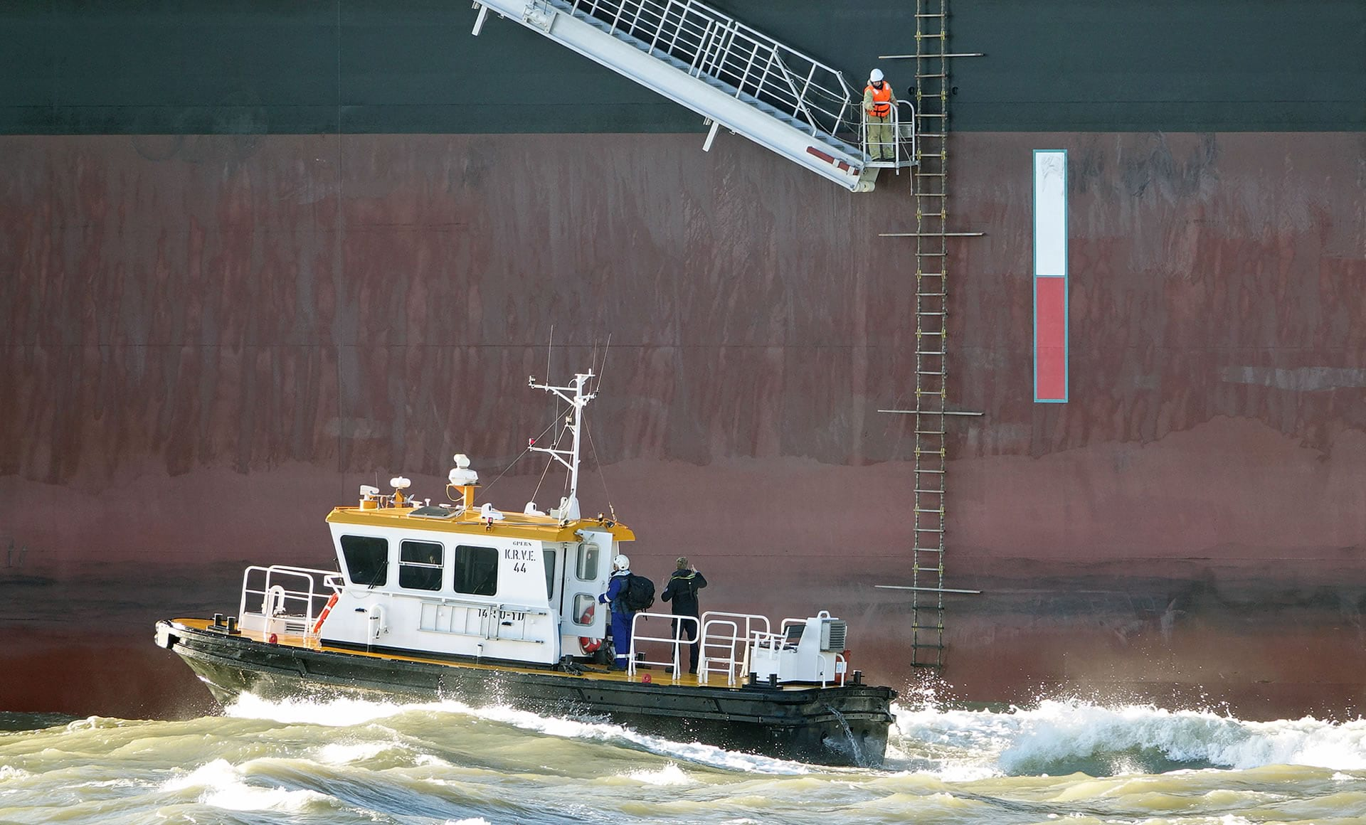 A specialized local pilot is delivered to a large vessel.