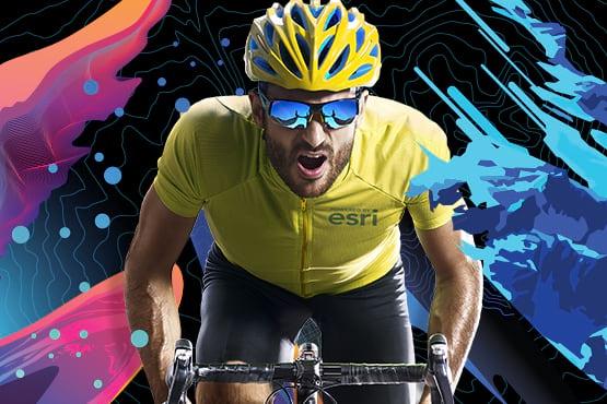 Esri UC Virtual Run/Walk/Bike 2021 cyclist wearing mirrored sunglasses and wearing a yellow jersey riding toward you