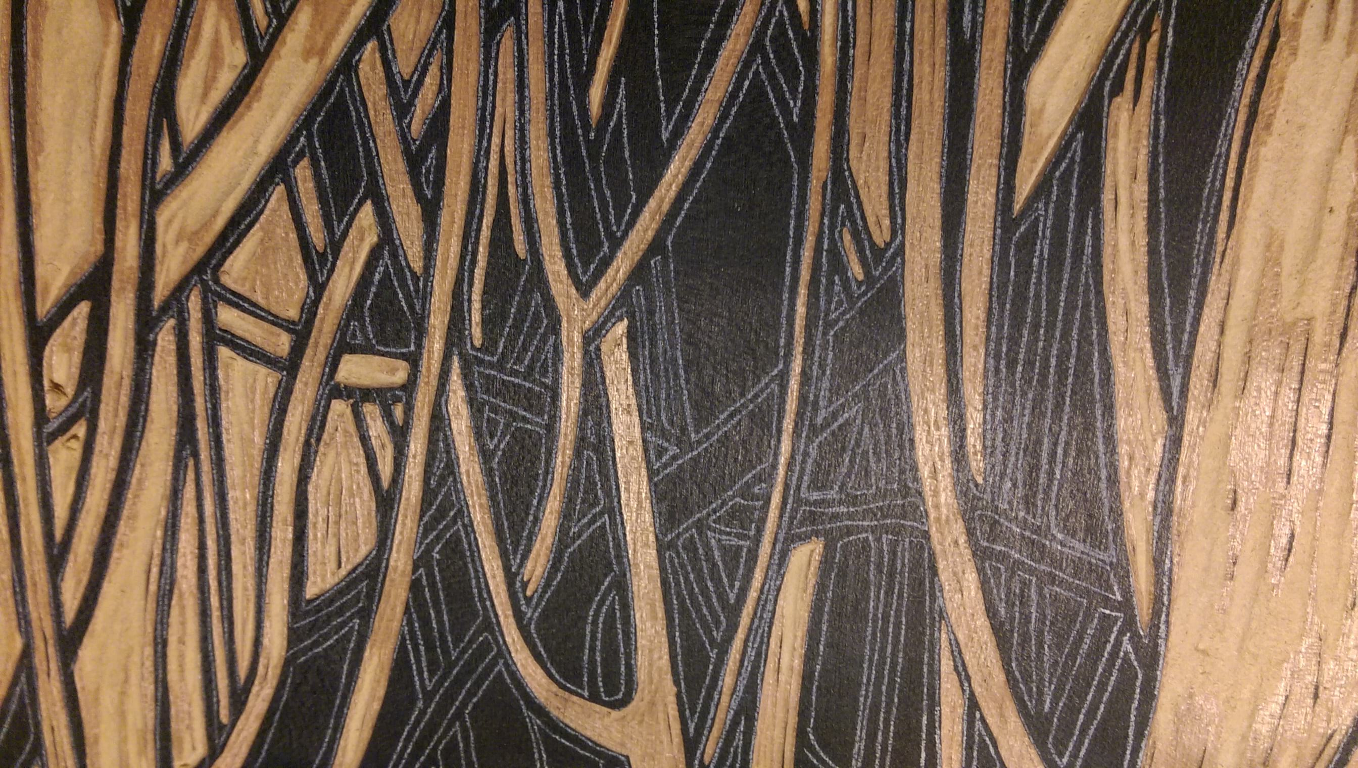 A woodcut in progress, showing white traced lines.