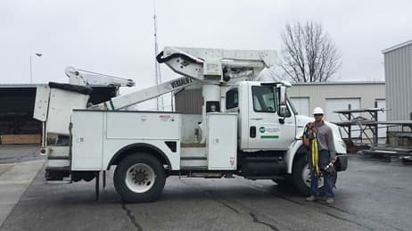 Utility truck and repair worker