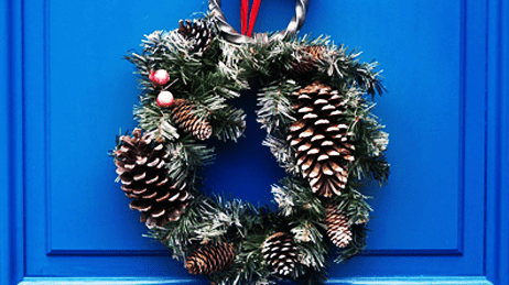 Holiday wreath on a blue door