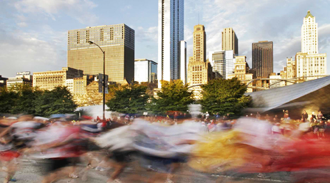 Chicago city skyline with runners passing in a blur