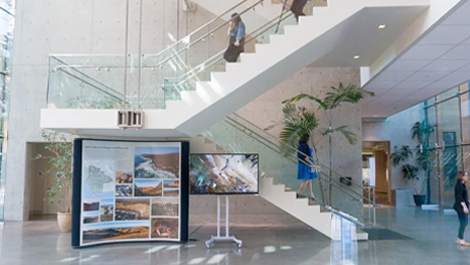 A staircase inside Esri Headquarters with people ascending and descending