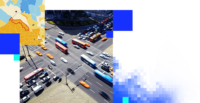 Busy intersection with buses and cars with an inset map