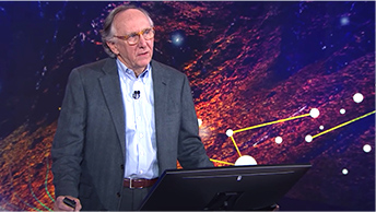 CEO Jack Dangermond standing at a podium in front of a blue and pink background