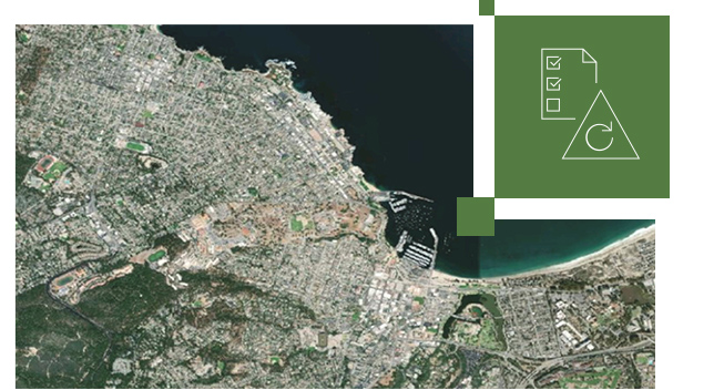 Satellite image of city with gray buildings and green land and a smaller image of a paper with checks on it