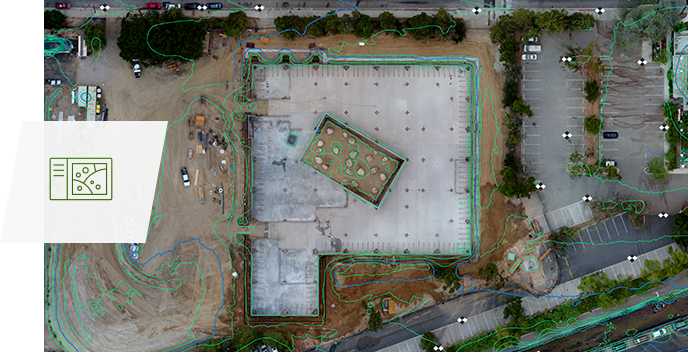 Aerial photograph of a building with parking lots with an added layer of topographical markings
