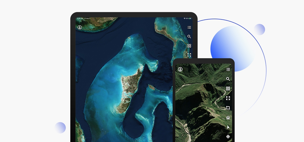Tablet displaying satellite image of land and water and a mobile phone showing aerial imagery of rolling green hills