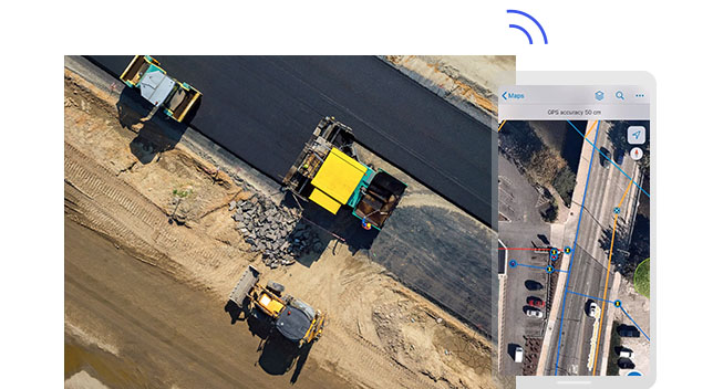 Aerial view of construction vehicles and a screenshot of their location on a map