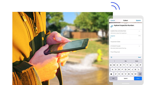A person holding a mobile phone inputting the location of a fire hydrant that is pouring out water in the background