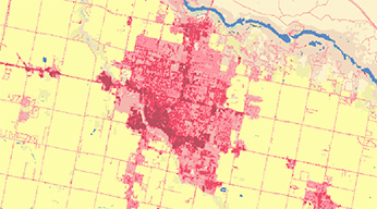 A yellow 2D map showing a densely populated area in red