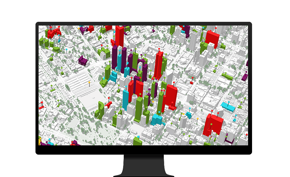 Computer monitor showing 3D visualization of buildings in a city