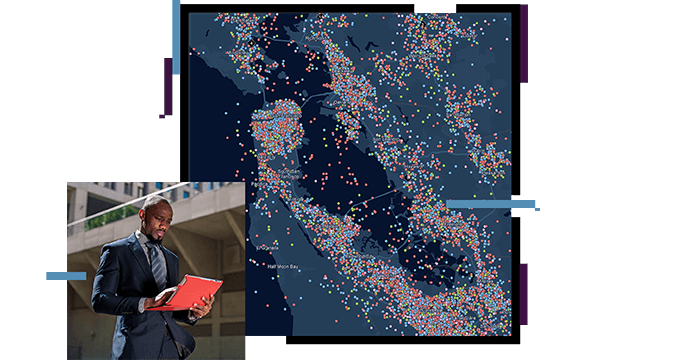 Man looking at a laptop, map with densely placed dots