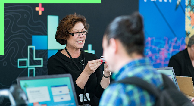 Woman helping attendees at the Esri User Conference