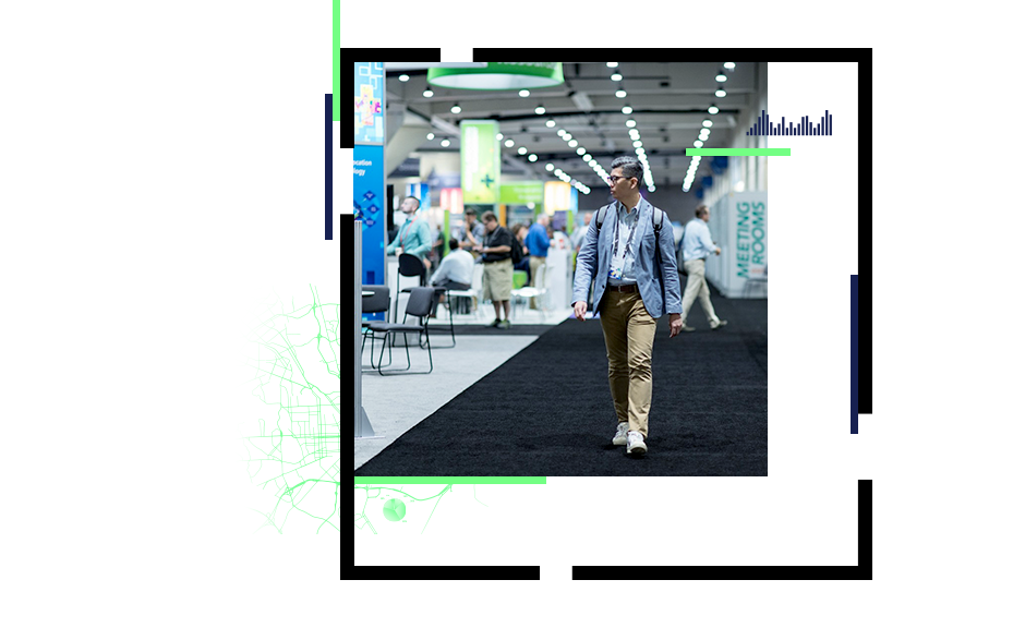 Man walking through exhibition hall at a conference