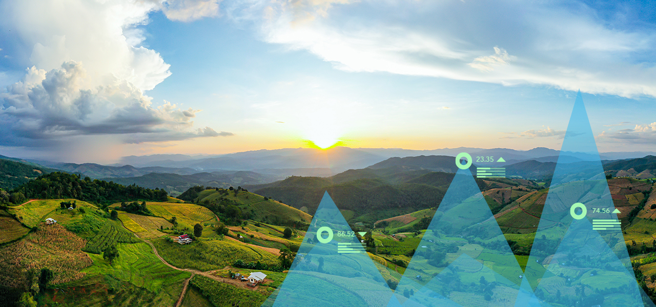 Landscape of green mountains with two triangle graphics on top