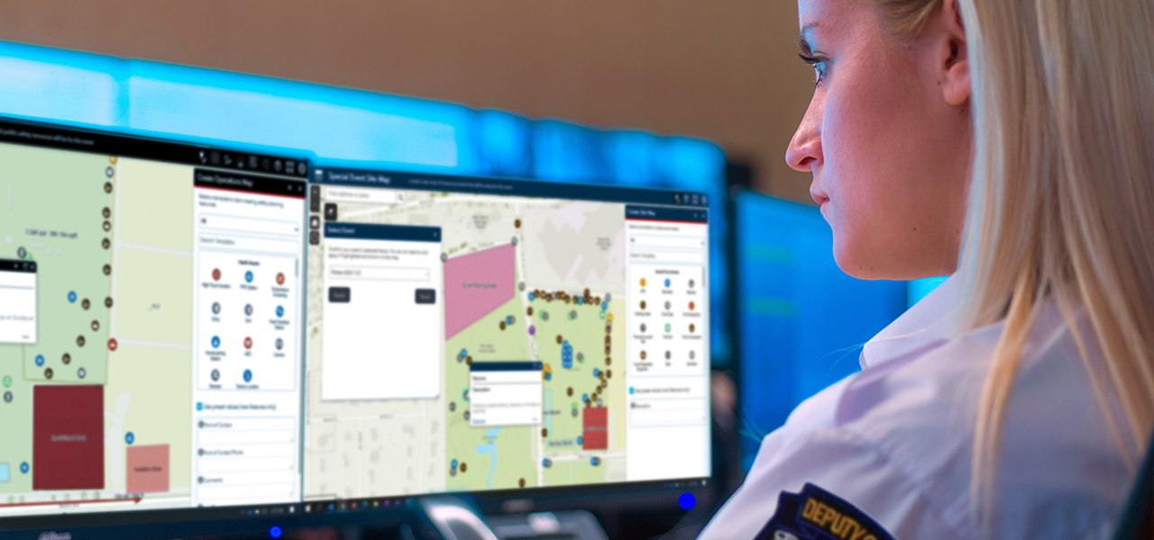Person looking at two computer monitors with a special event operations map and special event site map