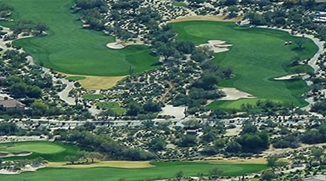 Aerial photo of a golf course near houses