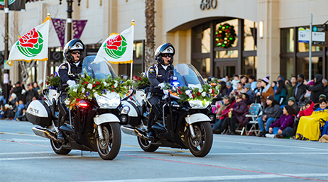 Police officers riding motorcycles on a parade route