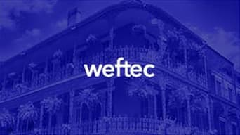 Blue over toned photo of a colonial building with the word 'Weftec' at the center