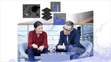 Professional woman and man interact with a tablet showing maps and graphs