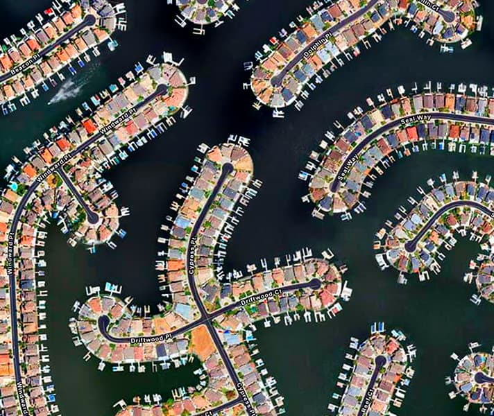 Aerial image of a series of homes and docks on water