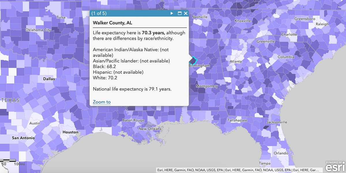 A screenshot of ArcGIS software displaying a purple map and a dialog box showing life expectancy information for Walker County, Alabama