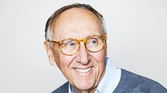 A portrait of Jack Dangermond, smiling
