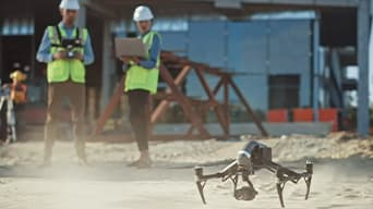 Two workers wearing safety helmets and vests working outside, operating a drone