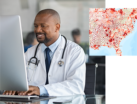 Man wearing a lab coat and stethoscope sitting at a computer and a map of the eastern United States with red dots overlaid
