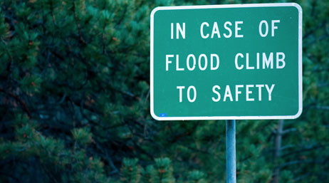 Sign warning residents to climb to safety in case of flood