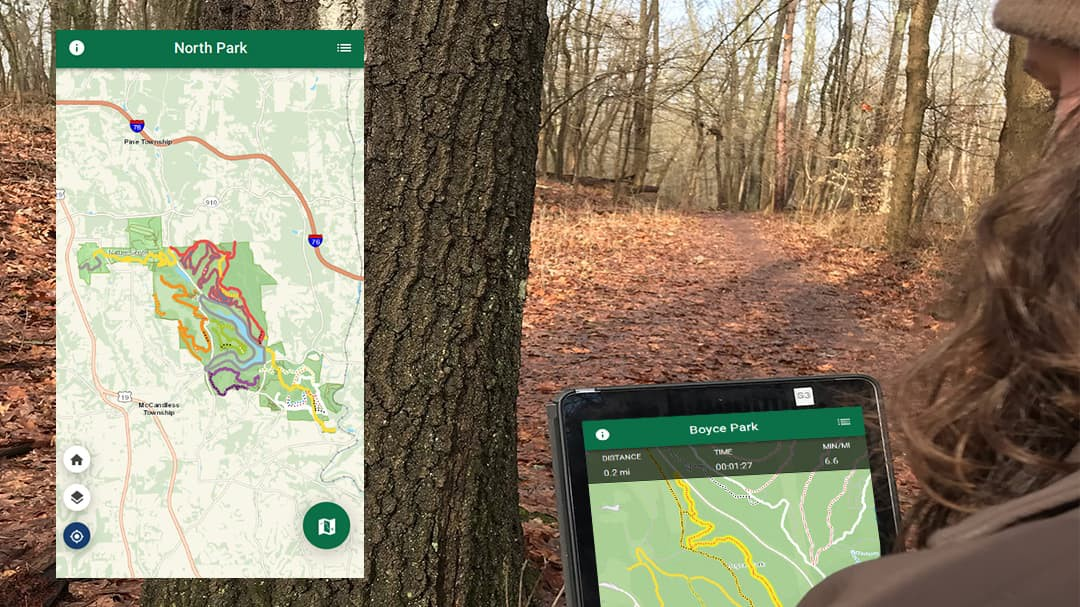 An Allegheny County park ranger uses the Allegheny County Parks Trails app on her mobile device.