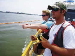 photo of crews on a boat gathering data